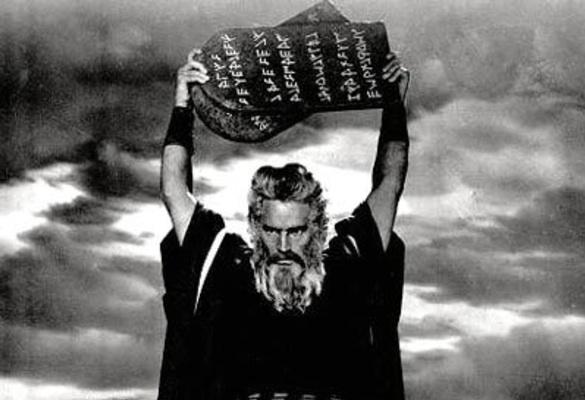 Charlton Heston as Moses holding up the Ten Commandments