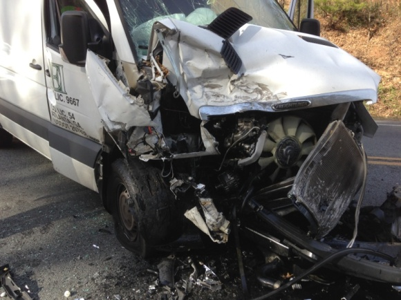 photo of a van after a collision