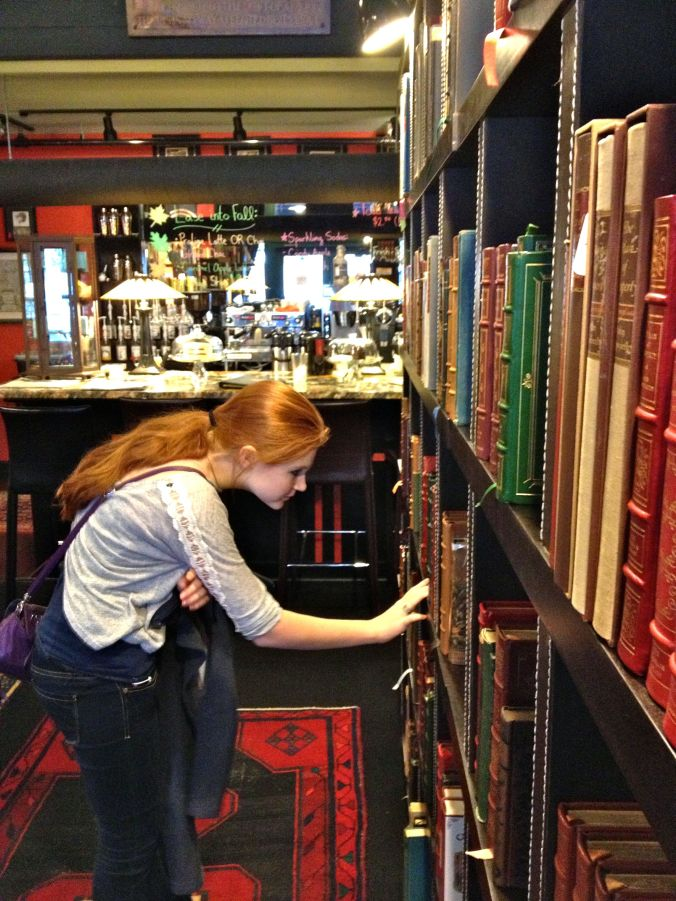 photo of Heidi browsing books in Asheville