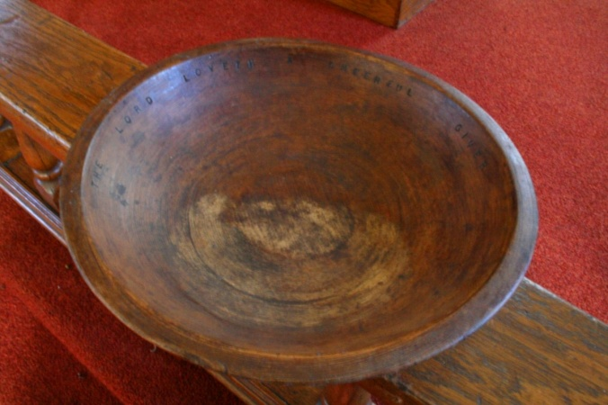 photo of hand carved offering plate