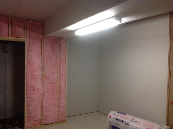 sheetrocking our basement storage room