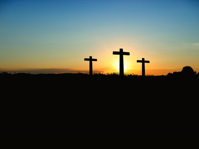 Sunrise over three crosses