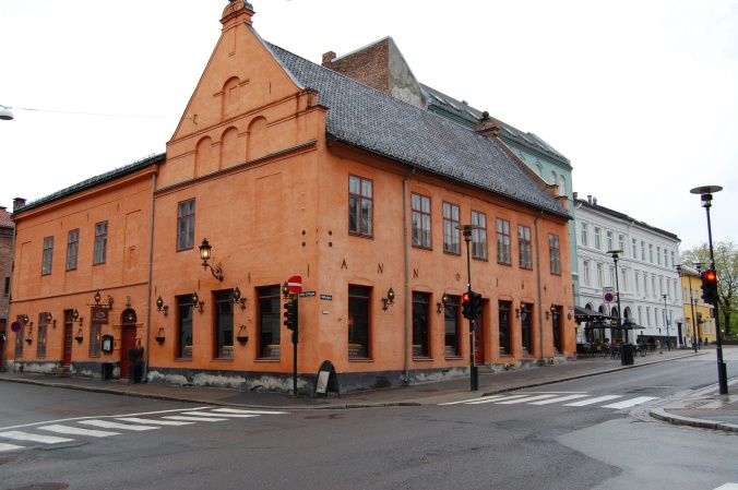 a coral colored building in Oslo, built 1641