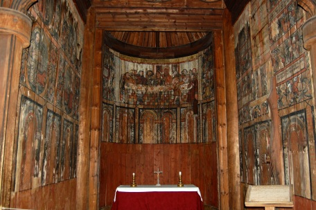 Original 12th century painted wood panels behind the altar