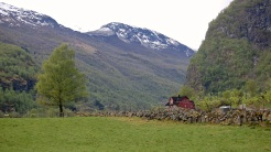 Field, Farmhouse, and Mountain in Lunden, Norway