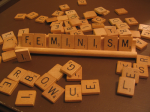 Feminism spelled in Scrabble letters