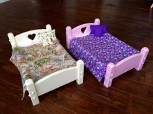 Doll beds showing heart in headboard