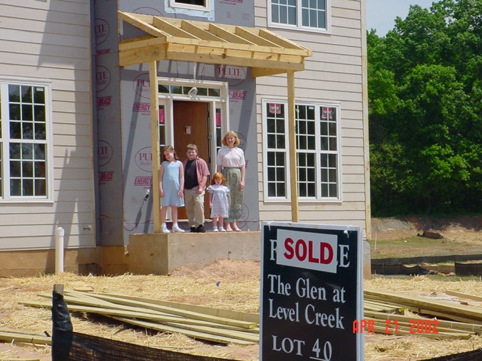 Our home in progress with sold sign. April 2, 2002.
