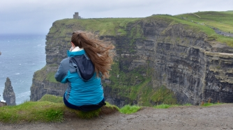 Haley sitting on the edge of the Cliffs of Moher